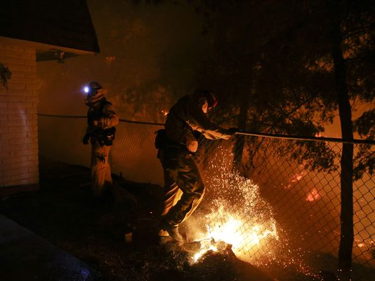 Wildfires roar in California, teens arrested for arson